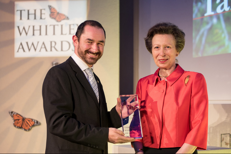 "Dr Ian Little receiving his Whitley Award. <b>Photo</b> James Finlay for the <a href=""https://photos.google.com/share/AF1QipPU3ECYi3Ia8n4eNqoZru5qxR82QIAXt9mrrHas7AZoaAvwxrY42tef9yEXbmncvg?key=RnF0NC1FSmRrQU40QUNHMUV2dmlPSzRKRGd3YXZR"" target=""_blank"" style=""font-weight: normal;"">Whitley Awards</a>."