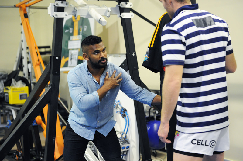 Dr Sharief Hendricks, who is designing a contact training programme for rugby players, tests the contact simulator. <strong>Photo</strong> Michael Hammond.