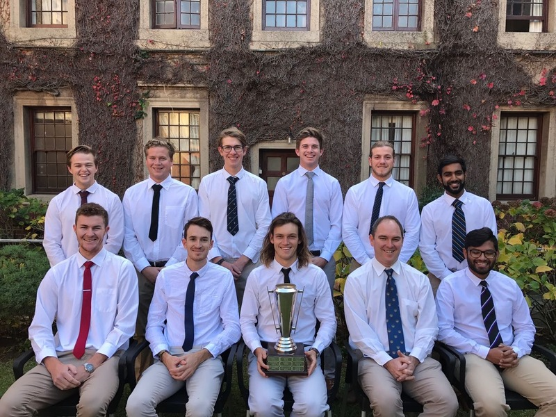 The UCT Cricket Club committee with their Club of the Year trophy.