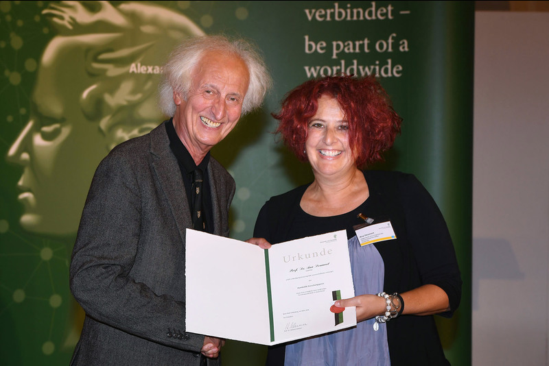 Sociolinguist Prof Ana Deumert receives the laudation for her Humboldt Research Award from Professor Helmut Schwarz, president of the Alexander von Humboldt Foundation, in Berlin.