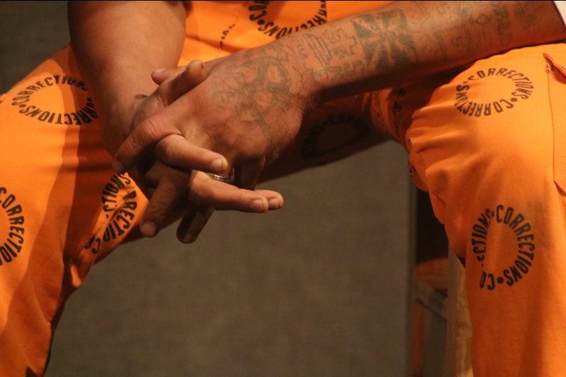 Wearing his life on his arms, an inmate contemplates his future.