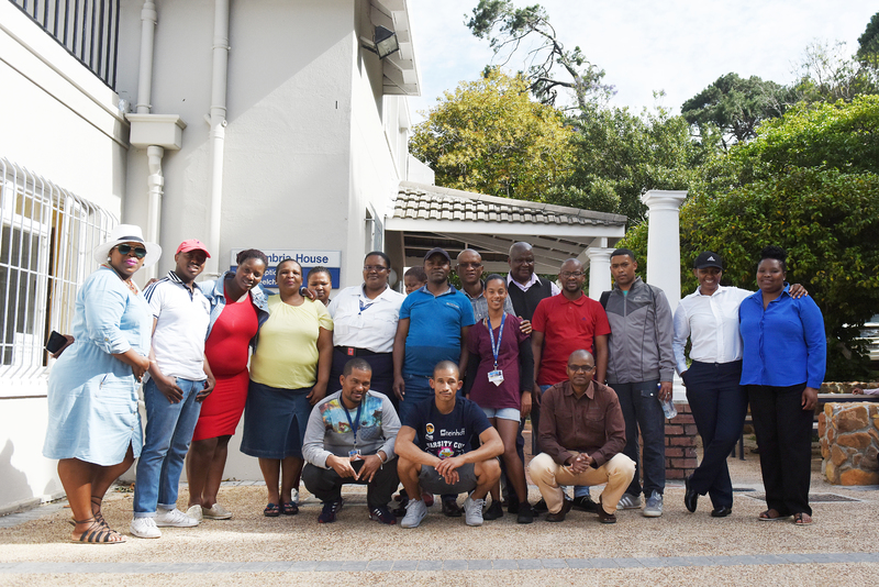 Members of Properties and Services outside Cambria House where they are tackling after-hours matric and basic adult education and training pilot programmes.