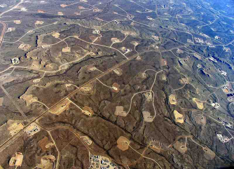 "An aerial view of gas wells in Wyoming. <b>Photo</b> Bruce Gordon for <a href=""http://ecoflight.org/index.php?mact=eco_gallery,cntnt01,default,0&amp;cntnt01returnid=42&amp;cntnt01page=3&amp;cntnt01issue=3&amp;cntnt01flight=12"" target=""_blank"" style=""font-weight: normal;"">Eco Flight</a>."