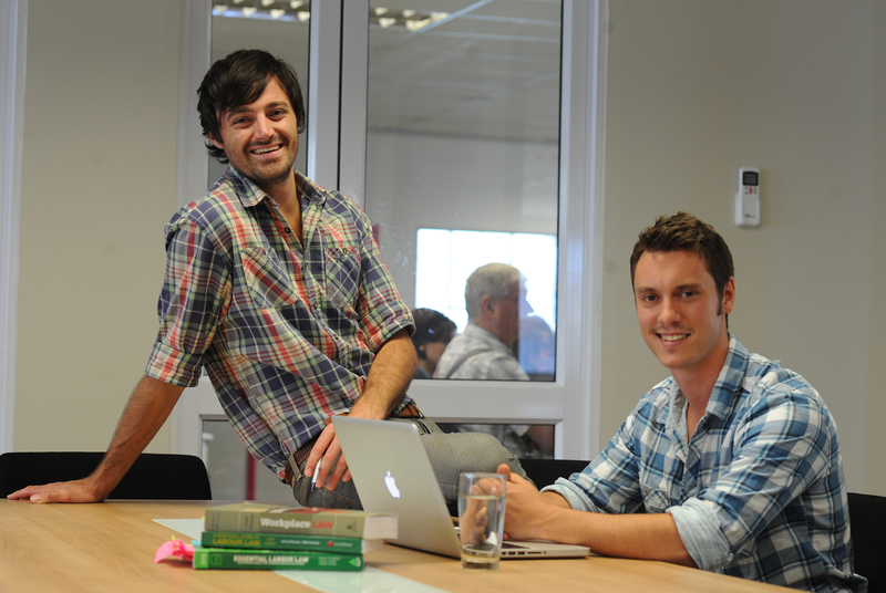 Check those shirts: (from left) Max Cromarty (sales and marketing executive) and Richard Burge (project manager) took time out to crack a smile at the UCT Law@Work Club's offices.
