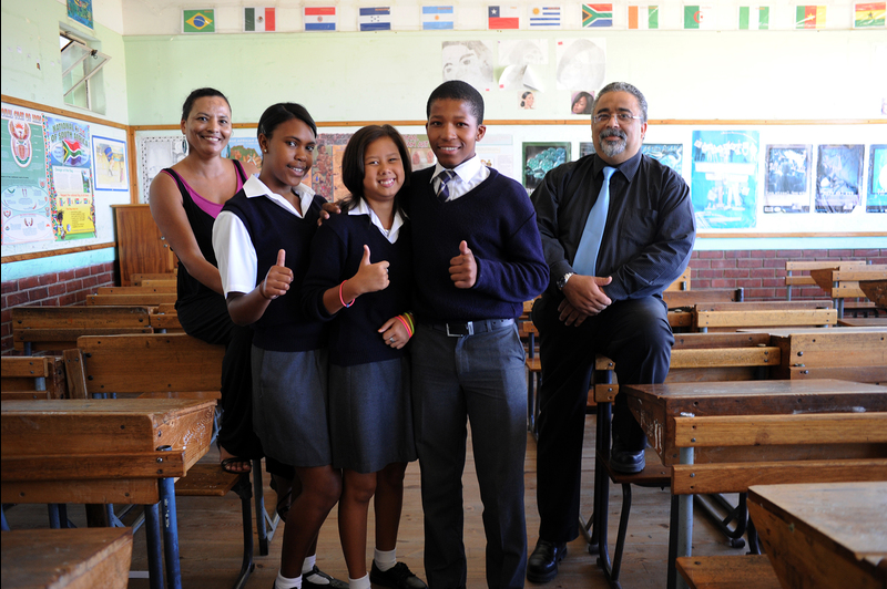 To the top: Three Windermere students achieved top results in 2012, thanks to SHAWCO's after-school projects. Shamielah Reid, Aaliyah Agouhaar and Lindani 'Theo' Luningo were photographed with centre manager Karen Damon (left) and Principal Craig Leetz (right).