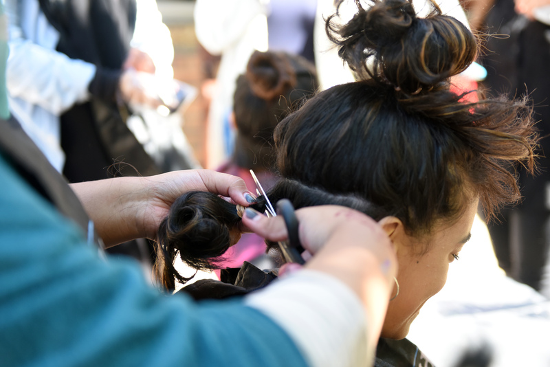 A participant opts to donate a ponytail at the 2017 CANSA Shavathon. Donations of human hair are used to fashion wigs, provided free of charge, for cancer patients experiencing hair loss.