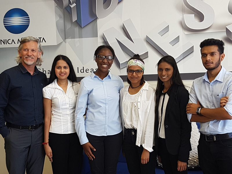 Richard Berg, manager of Corporate Business Solutions at KMSA Cape Town, with the UCT team that took national honours in the Konica Minolta International University Contest.