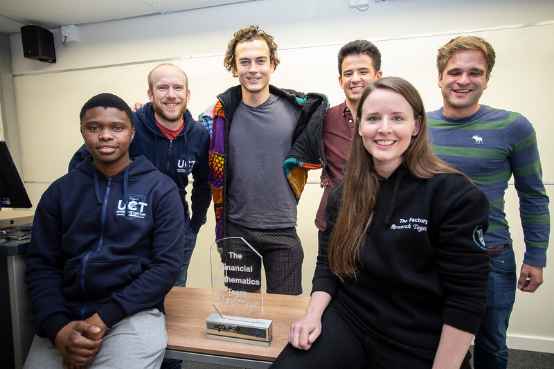 The winning team included UCT financial maths master's students Bandile Mbele (left, front) and Cole van Jaarsveld (middle, back).