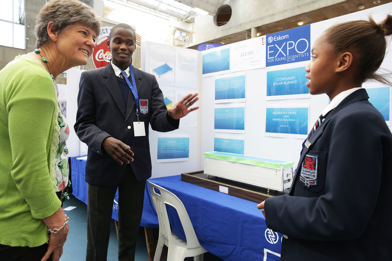 Nikwe Ngabelwa (left) and Nerissa Sucram, from Simon's Town School, tell the Deputy Dean of the Science Faculty, Prof Nicola Illing, about their project to use solar blankets on shipping containers.