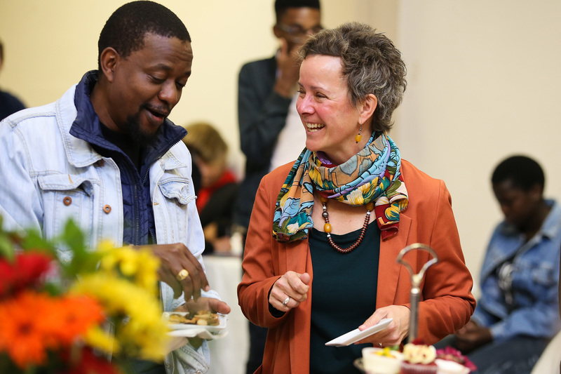 Assoc Prof Suellen Shay, who is stepping down as CHED dean, shares a laugh at her farewell tea with Daniel Munene, head of department of the Education Development Unit (EDU).