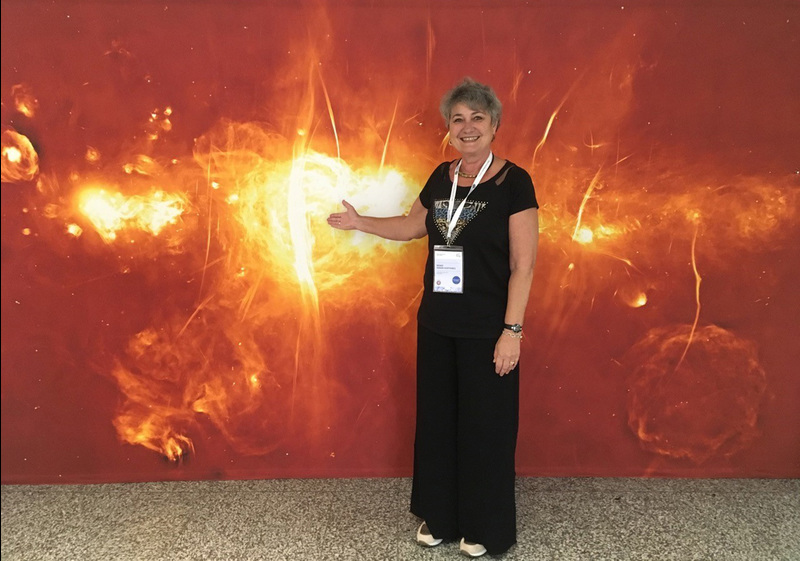 UCT Chair of Astronomy Prof Renee Kraan-Korteweg photographed in Vienna at the General Assembly of the International Astronomical Union the day after the SAWISA event. The MeerKAT image behind her was released at the MeerKAT launch, and featured at the MeerKAT exhibition booth in Vienna.
