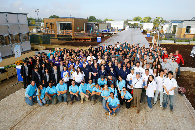 "The official all-teams photo from last year's Solar Decathlon in Denver, Colorado. The picture also shows the reassembled entries on the site. <b>Photo</b> <a href=""https://www.solardecathlon.gov/2017/photos-event.html"" target=""_blank"">Jack Dempsey, US Department of Energy Solar Decathlon</a>."