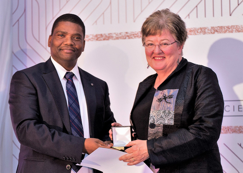 Prof Anna-Lise Williamson receives her award from Prof Jeffrey Mphahlele, vice-president of the SA Medical Research Council (SAMRC)