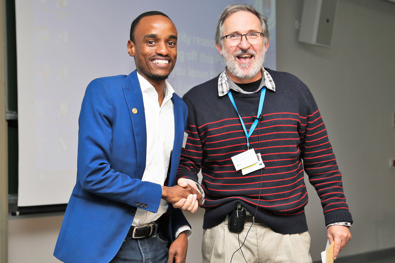 Science category and People's Choice winner Rene Nsanzubuhoro, assistant lecturer in the department of Civil Engineering (left), is congratulated by Professor Peter Meissner, director of the Office of Postgraduate Studies and chair of the event