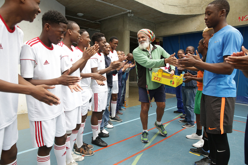 Players formed a guard of honour to welcome Peter Buckton to the final game he refereed at UCT last week.