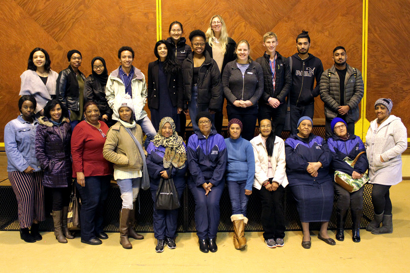 Nabeelah Gani (fifth from left, second row) and Josh Fieggen (third from right, second row) join their fellow fourth-year medical students and community members who attended the first-aid workshop for a commemorative picture. Christolene Beauzac-McKay, UCT's site facilitator in Mitchell's Plain, is second from left, second row.