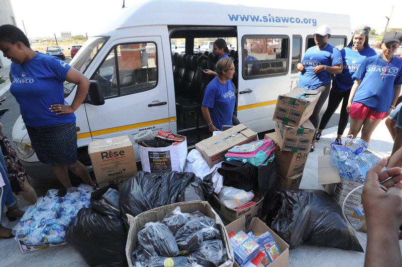 SHAWCO members deliver their busload of donations to the people left homeless by the recent devastating Khayelitsha fire.