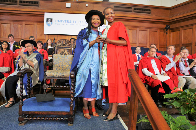 Lauded academic, author, activist and UCT alumnus Prof Pumla Dineo Gqola (right) received the President of Convocation medal from VC Prof Mamokgethi Phakeng.