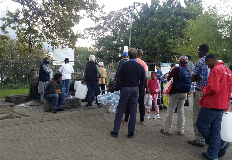 "Capetonians queue up at local springs during the height of water restrictions in the city, when everything was being done to avoid the prospect of Day Zero when the taps would ultimately run dry. <b>Photo</b>&nbsp;<a href=""https://www.flickr.com/photos/154236228@N02/28314612188/"" target=""_blank"">Widad Sirkhotte, Flickr</a>."