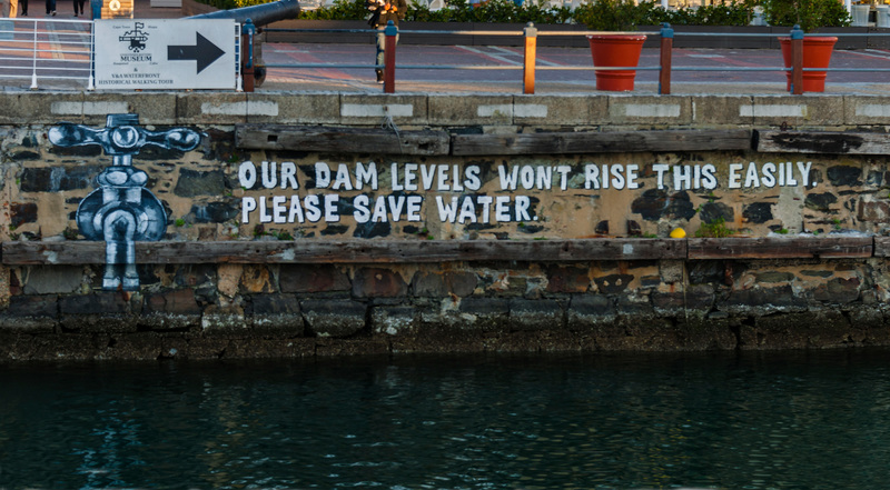 A mural promoting water conservation efforts on a retaining wall at Cape Town's V&A Waterfront during the height of the water restrictions in 2018.