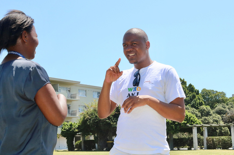 UCT's Qobo Ningiza on campus with sign language interpreter Tshepiso Mokoena.