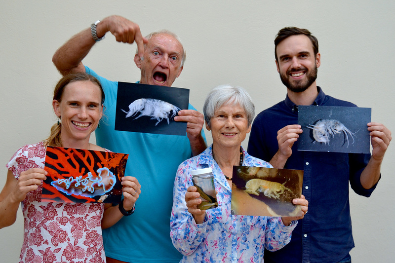 Members of the Griffiths family with images of the marine and freshwater species named after them. They are (from left) Dr Melinda Griffiths, Emer Prof Charles Griffiths, Dr Roberta Griffiths and Matthew Griffiths. <b>Photo</b>&nbsp;Supplied.