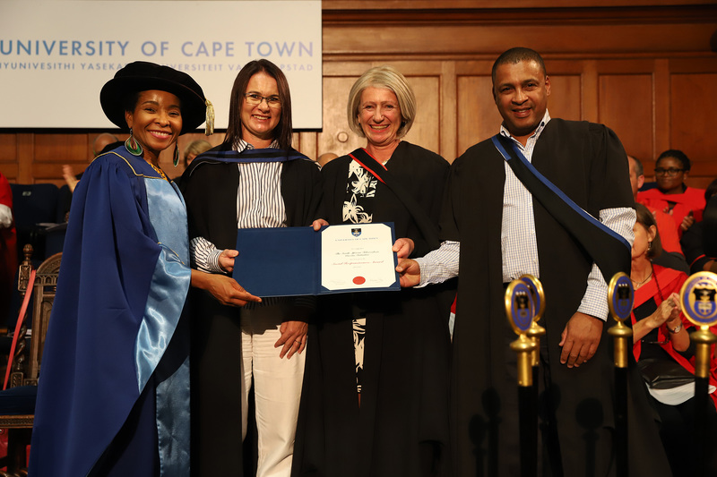 SATVI representatives (from second from left) field site manager Marwou de Kock, senior research officer Dr Michèle Tameris and Kelvin Vollenhoven, communications and marketing manager, collect the Social Responsiveness Award from VC Prof Mamokgethi Phakeng (left) at the Faculty of Health Sciences graduation ceremony on Saturday, 13 April. <b>Photo</b>&nbsp;Michael Hammond.