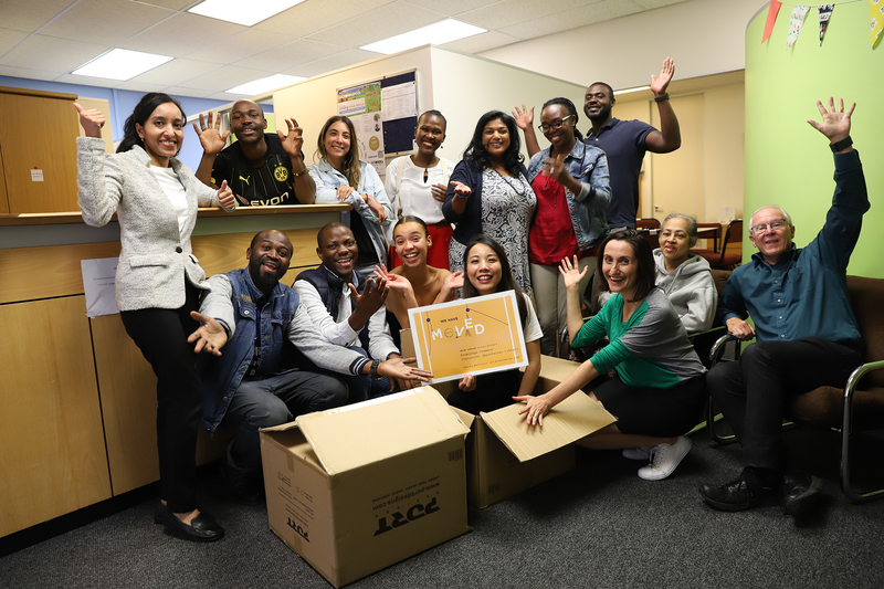 The Writing Centre team packs up ahead of their move to their new home in the main library's Vincent Kolbe Knowledge Commons. They are (back from left) Gustav Mbeha, Nicole Isaacs, Yakhuluntu Dubazana, Desireé Moodley, Kendi Osano and Zimpande Kawanu, and (front from left) Aditi Hunma, Joel Ntando, Munashe Chideya, Qiniso van Damme, Jenny Pan, Gabrielle Nudelman, Gadija Arend and Deryck Sheriffs.