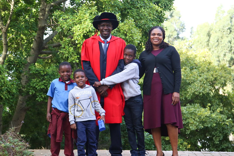Prof Shadreck Chirikure with his wife, Geraldine, and two of their sons, Tadanaishe and Tawananyasha (embracing Chirikure) with friend Tawanaishe Mundembe (far left). Absent from the family picture is the couple's youngest son, Tafara.
