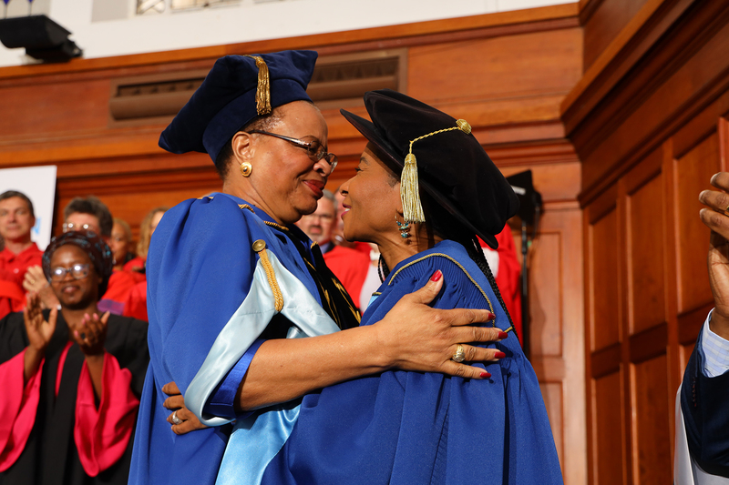 Graça Machel's second 10-year term as chancellor ends this year. She is seen here embracing VC Prof Mamokgethi Phakeng at Phakeng's robing ceremony at the end of 2018. <b>Photo</b> Roger Sedres.