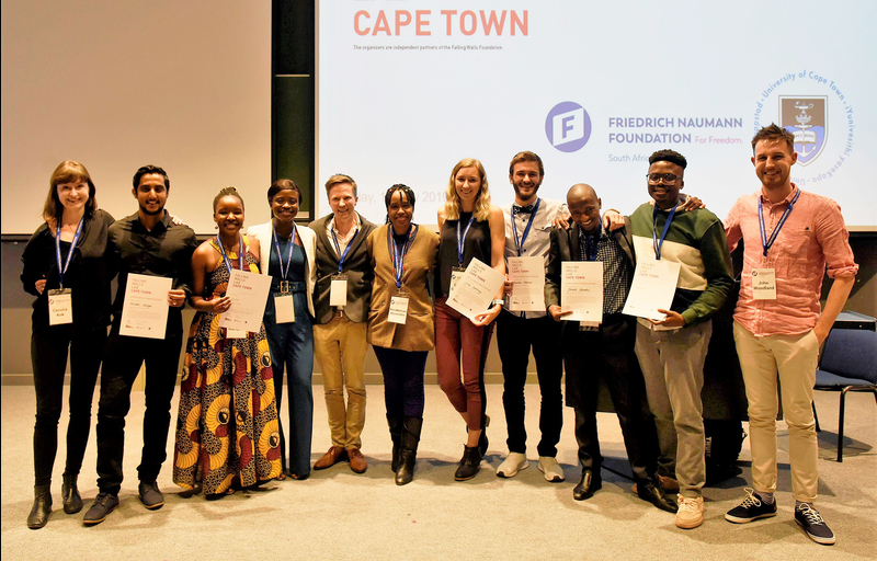 Winner of the Falling Walls Lab in Cape Town Hlumelo Marepula (third from left), who will compete against 99 other global finalists in Berlin. Also in picture are (from left) Cecelia Kok (Friedrich-Naumann Foundation), Avishek Dusoye, Sylvia Dorbor, Dyllon Randall (senior lecturer, Department of Civil Engineering), Resoketswe Manenzhe (2nd place winner), Caitlin Courtney, Denislav Marinov, Sikozile Ncembu, Vukheta Mukhari (3rd place winner) and John Woodland (postdoctoral research fellow, Department of Chemistry).