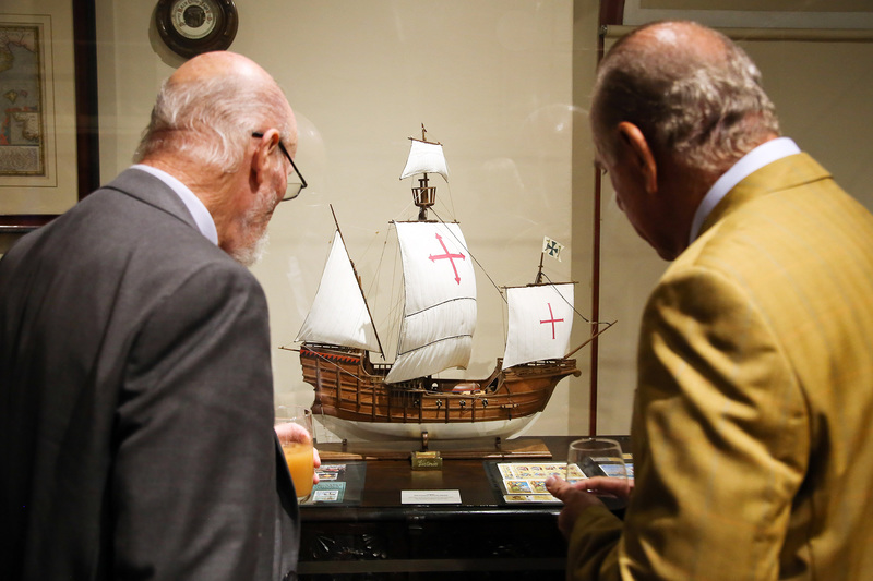 Guests at the exhibition to mark the 500th anniversary of the first circumnavigation of the globe examine a model of the Victoria, the only one of a fleet of five Spanish ships to complete the voyage.