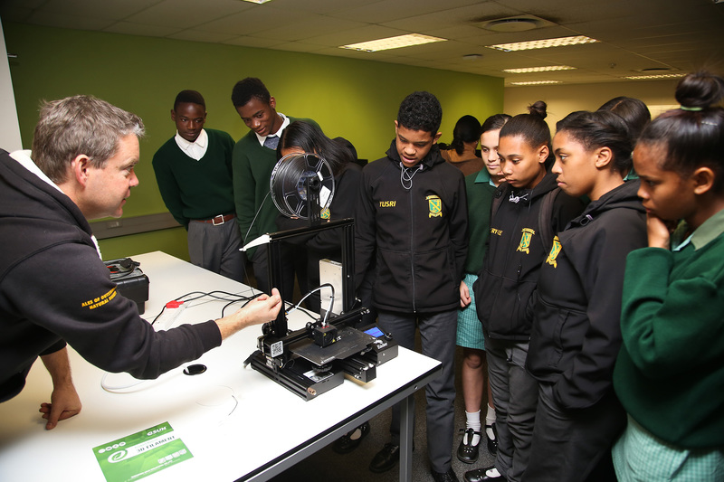 Ocean View Secondary School learners watch enthralled as a 3D print design becomes reality during their visit to UCT, organised in a bid to spark their interest in a career in computer science.