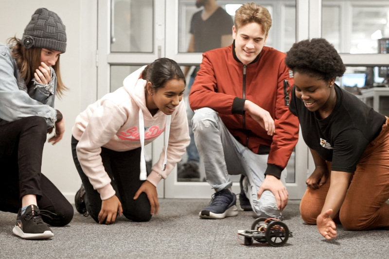 "Learners at #RoboCampUCT watch one of their robots ""come to life"" and move around the laboratory."