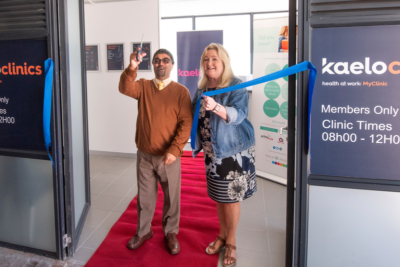 UCT COO Dr Reno Morar cuts the ribbon to officially open the KaeloClinic to all staff who are on the Kaelo Primary Health Care product.