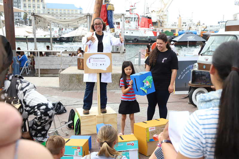 Dr Natasha Karenyi, from UCT's Department of Biological Sciences, keeps the crowds entertained during SA's first Soapbox Science event at the V&A Waterfront.