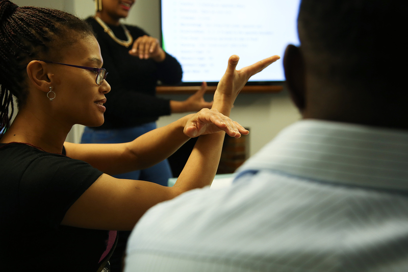 Staff learn sign language during a six-week pilot course on South African Sign Language in 2018.