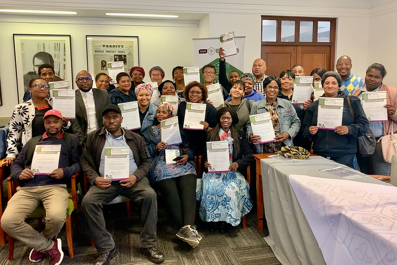 UCT staff proudly display their certificates after attending the latest financial literacy training session.