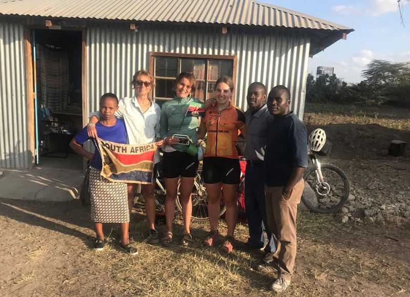 Deep in rural Africa, and without Wi-Fi, some good fortune helped civil engineering master's graduate Suzanne Lambert (third from left) turn in final corrections on her thesis.