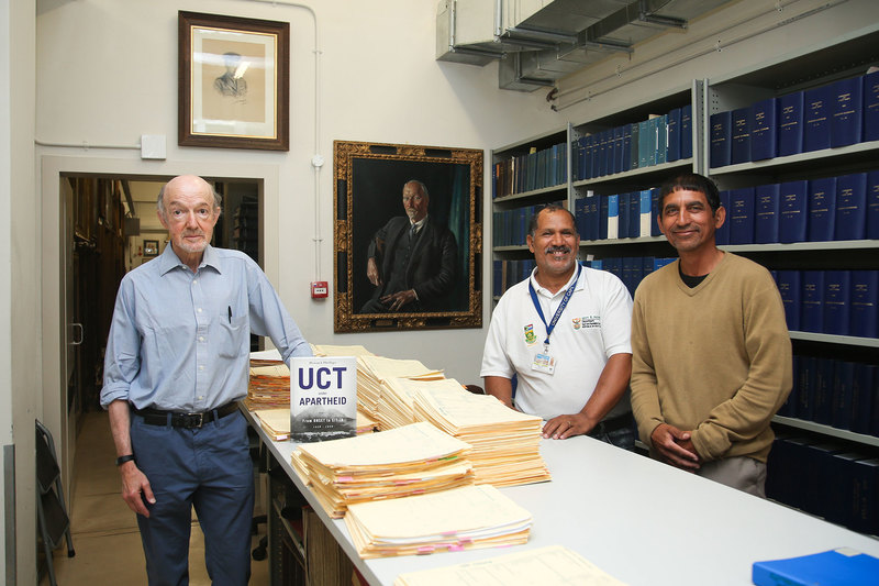 Emer Prof Howard Phillips with UCT archivists Stephen Herandien (middle) and Lionel Smidt (right), who played an integral part in the production of the book.