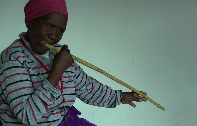 Matlali Khoane playing the lekope, a mouth-resonated bow.