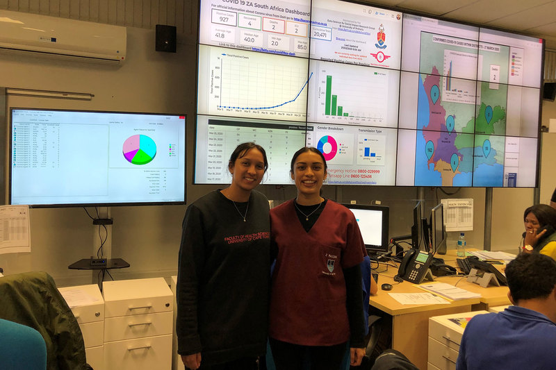 Fourth-year medical students Huda Abrahams (left) and Zaahidah Razzak are part of an over 100-strong group of UCT medical student volunteers who are staffing the COVID-19 hotline at Tygerberg Hospital's Disaster Management Centre.