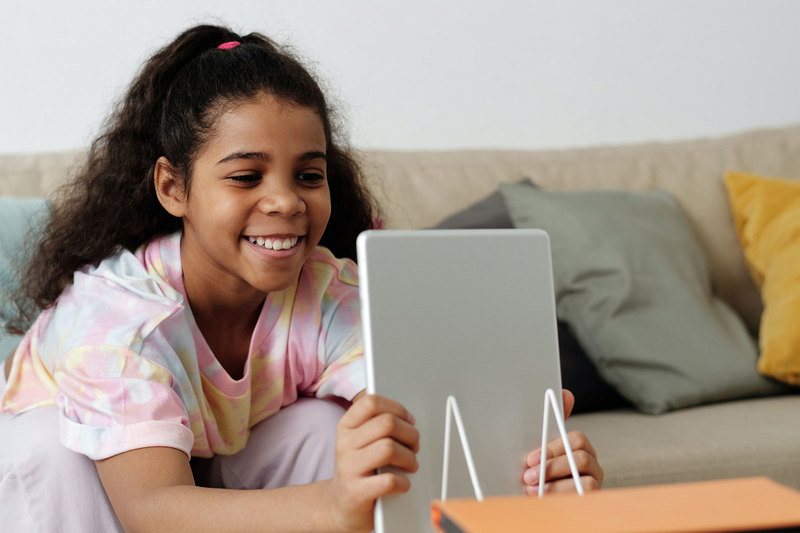 "&ldquo;Oaky and the Virus&rdquo; is free to download and suitable for children nine years old and younger. <b>Photo</b> <a href=""https://www.pexels.com/photo/photo-of-girl-smiling-while-holding-tablet-computer-4144103/"" target=""_blank"">Pexels</a>."