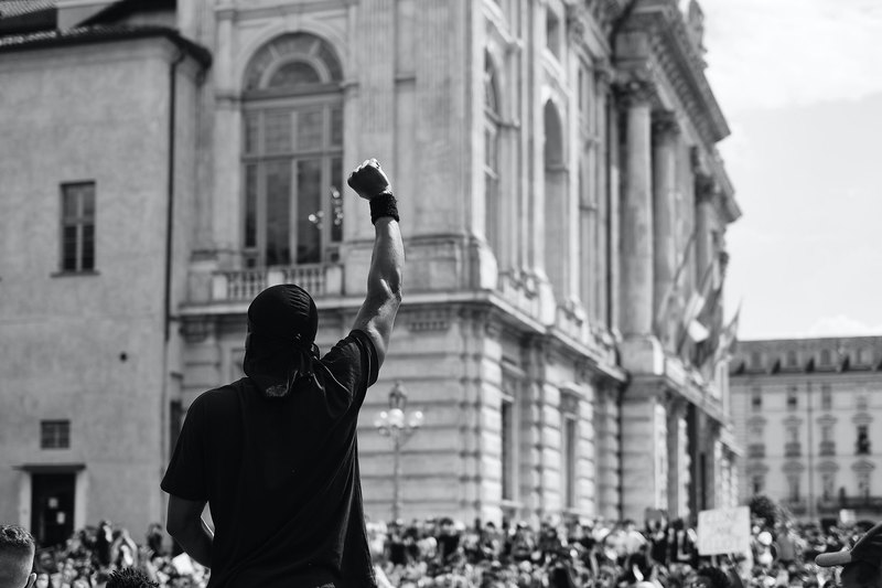"The COVID-19 pandemic provides us with the ideal opportunity to reimagine and rebuild. <strong>Photo</strong> <a href=""https://www.pexels.com/photo/man-in-black-t-shirt-standing-infront-of-a-crowd-in-protest-4677606/"" target=""_blank"">Marco Allasio/Pexels</a>."