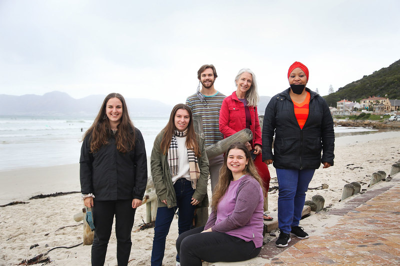 Dr Tessa Dowling (in red) with her third-year students (from left, front) Chloe McKellar, Stella Robbins and Finn Lewis (seated). (Back) Nic de Villiers and Liziwe Futuse, Dowling's PhD student and the section administrator. (Note: Masks were replaced immediately after the photo was taken.)