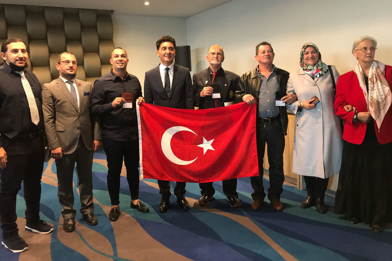 Dr Halim Gençoğlu (far left) photographed with Ottoman descendants who were awarded Turkish citizenship on 24 November. Turkish consul-general, Sinan Yeşildağ (in dark suit), presented the identity documents.