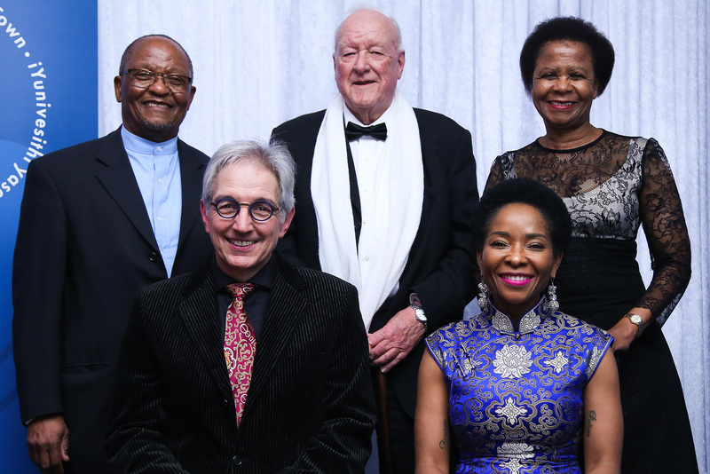 Dr Stuart Saunders (centre) next to Mamphela Ramphele (back right) and Prof Njabulo S Ndebele (back left) at the farewell gala dinner in 2018 for the outgoing vice-chancellor Dr Max Price (front left) and the incoming vice-chancellor Prof&nbsp;Mamokgethi Phakeng (front right). <strong>Photo</strong> Je&rsquo;nine May.