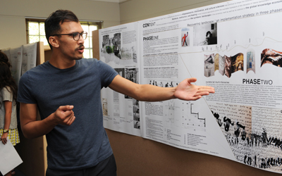 Sadiq Toffa, winner of the design competition to commemorate the slaves buried at the Rustenburg farm – now UCT's middle campus – explains the different phases of his winning proposal. <b>Photo</b>&nbsp;Michael Hammond.
