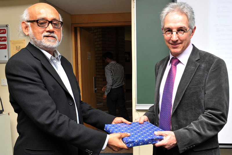Prof Partha Chatterjee from Columbia University accepts a gift from UCT Vice-Chancellor Dr Max Price after delivering a VC Open Lecture centred on colonialism and the power it still exerts on modern states.