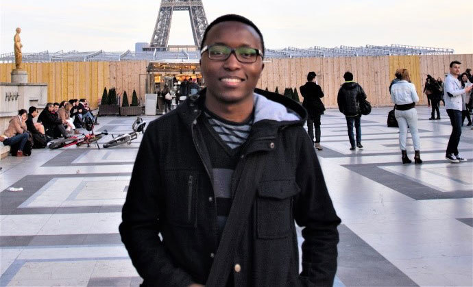 Musa in front of the Eiffel Tower.